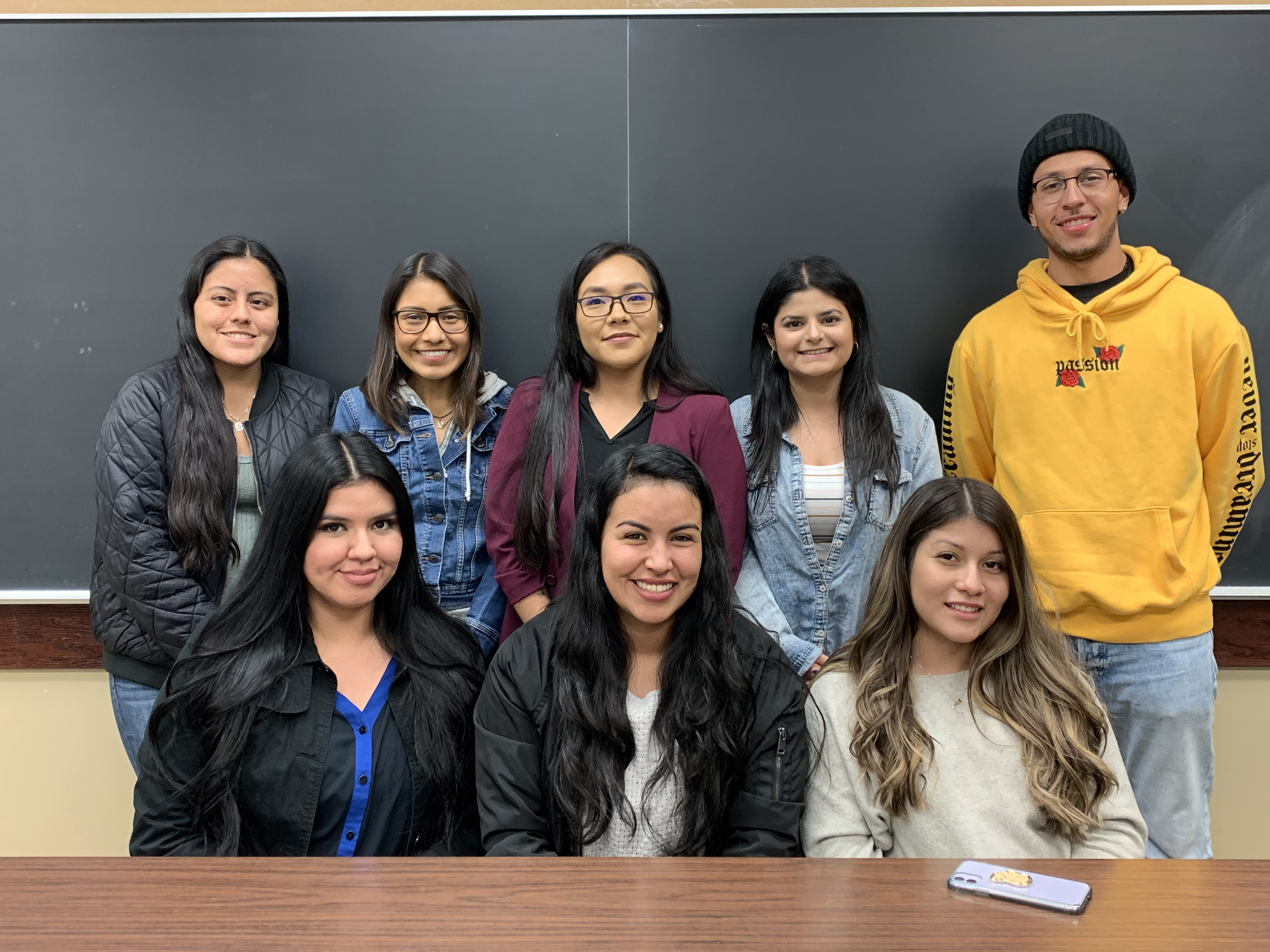 An image of the previous 2019-2020 UndocuBruins Research Program Cohort smiling indoors.